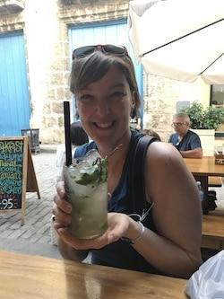 Beth in Havana holding a mojitor