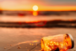 Sun setting over the water with a jar in front